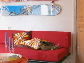 Cuscini X Divano Rosso, Rustico Two Skateboards On Wall Above, Sofa With Colourful Cushions In Modern White Living Room
