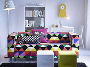 Divano Ikea Colorato, Elegante A Living Room With A Two-Seat Sofa Covered With A Colourful Cotton Fabric Together With, Footstools In White, Yellow